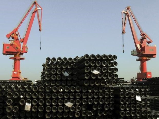 Cranes are seen above piles of steel pipes to be exported at a port in Lianyungang, Jiangsu province, China. Photo: Reuters