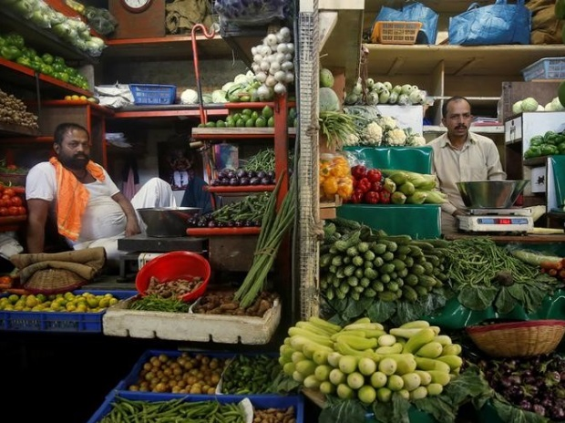 Vegetable vendors wait for customers in their stalls at a market in Mumbai