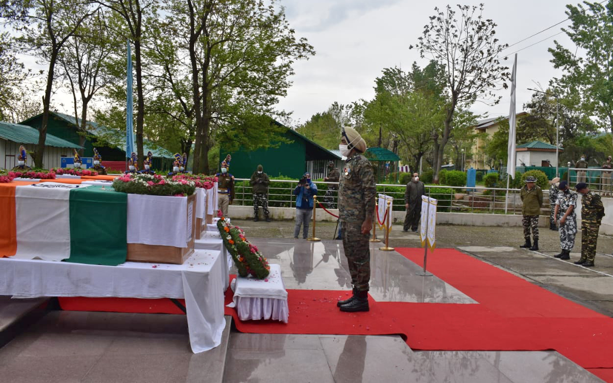 Wreath-laying ceremony of the 3 CRPF personnel who lost their lives in the Sopore militant attack yesterday, in Sopore on Sunday.