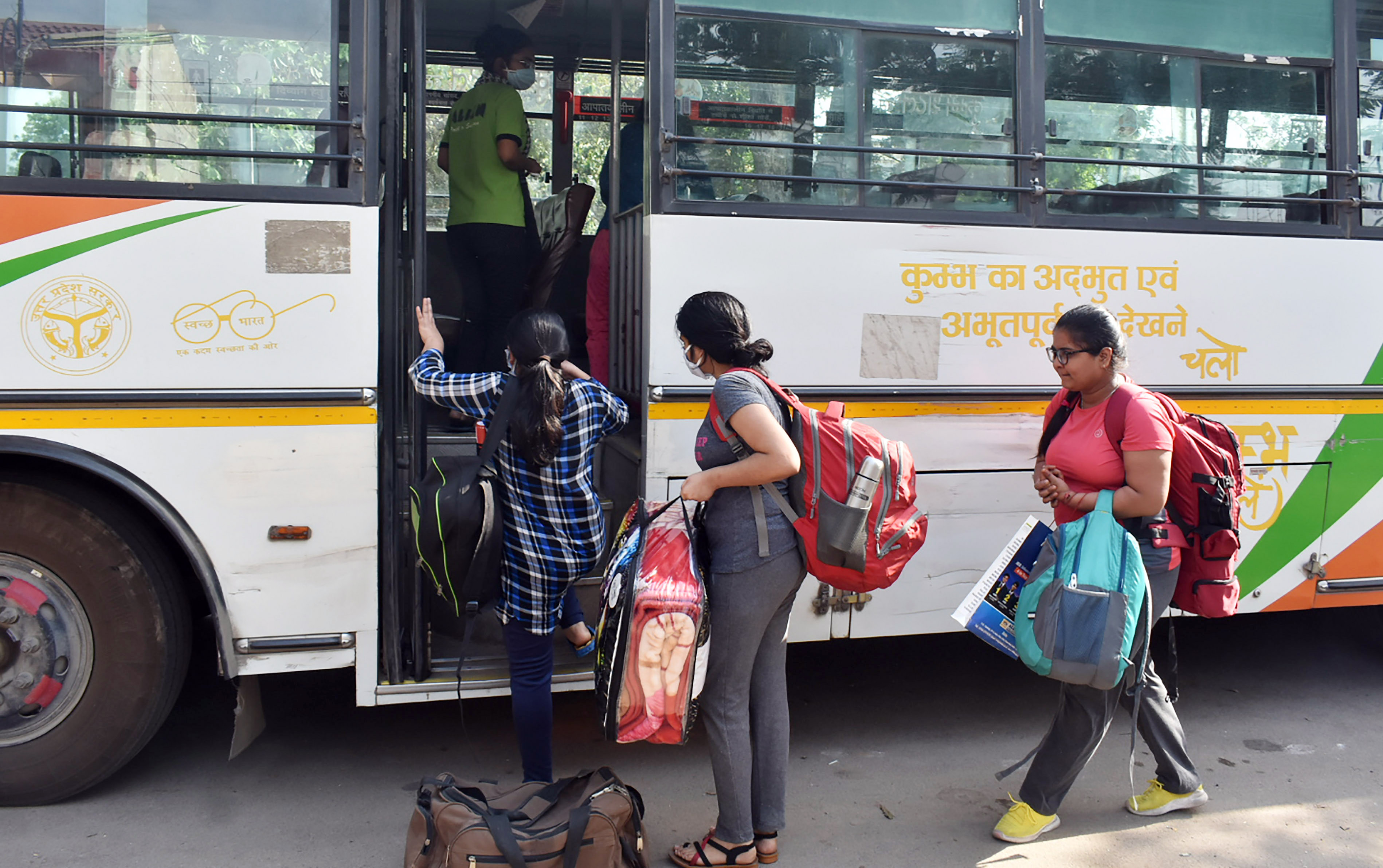 Students who were stranded in Kota due to ongoing COVID-19 nationwide lockdown, leave for their houses after medical checkup as they were brought by U.P. Government buses at a quarantine center, in Prayagraj on Sunday.