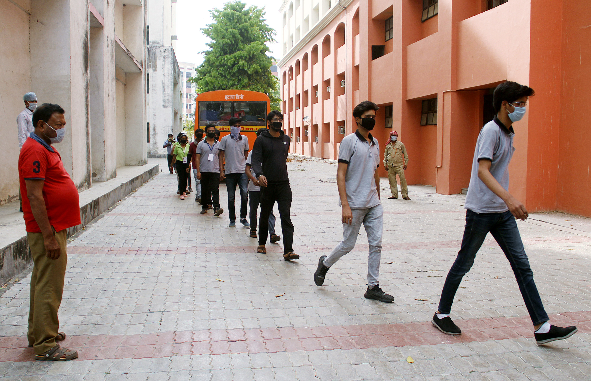 Students who were stranded in Kota brought back by UP government arrives at quarantine centre of BBD University for a medical checkup during coronavirus lockdown, in Lucknow on Sunday.