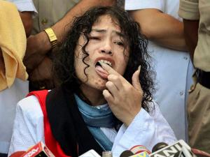 Irom Sharmila  licks honey from her hand to break her fast