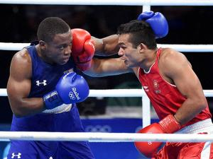 Vikas Krishan  (red) fights Charles Albert Shone Conwell of USA in Preliminaries Men's Middle (75Kg)